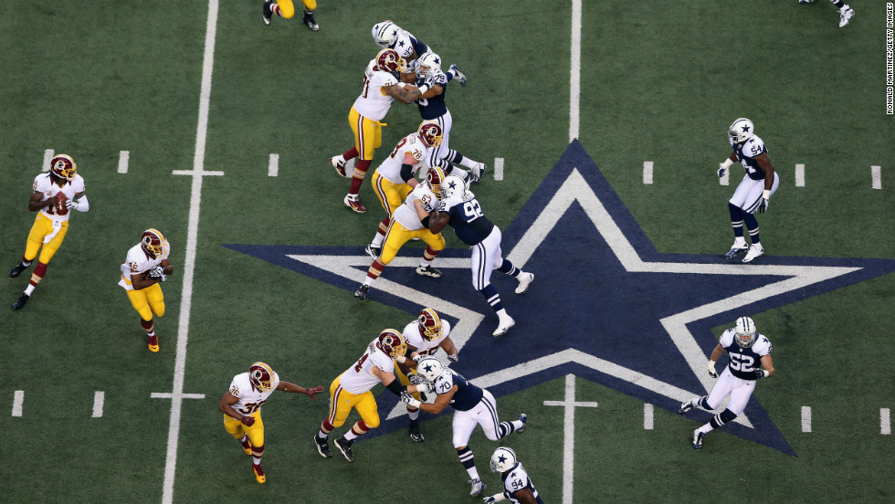 Robert Griffin III of the Washington Redskins, at left, looks to pass against the Dallas Cowboys.