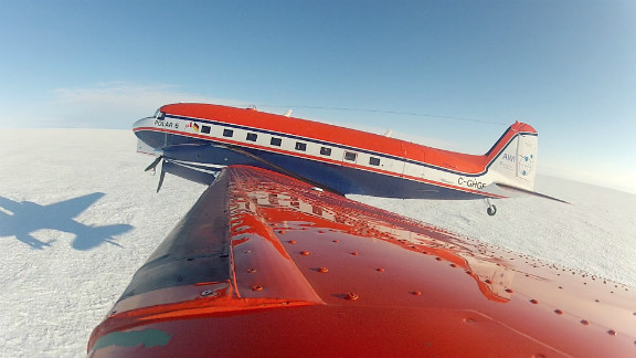 POLAR 6 takes off from the Greenland ice shield after a successful ice-core drilling mission.