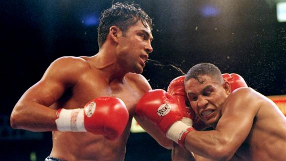Oscar De La Hoya battles Camacho during a match in Las Vegas on September 13, 1997.