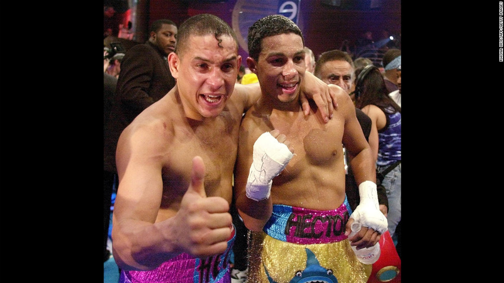 "Camacho and his son, undefeated super lightweight champion Hector ""Macho"" Camacho Jr., celebrate their wins in Miami on February 3, 2001. They were the first father and son tandem to share the same boxing card since 1975."