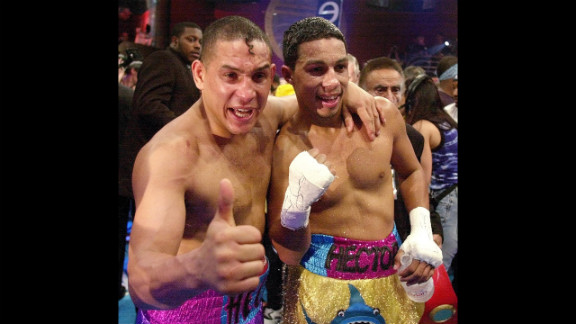 """Camacho and his son, undefeated super lightweight champion Hector """"Macho"""" Camacho Jr., celebrate their wins in Miami on February 3, 2001. They were the first father and son tandem to share the same boxing card since 1975."""