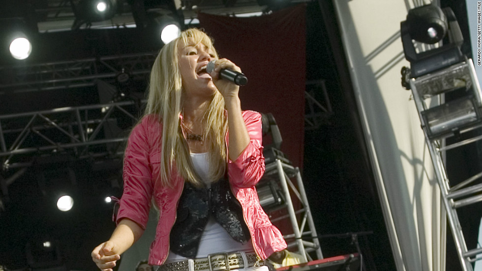"Before she turned 15, the young star was selling out concert stops as ""Hannah Montana"" and as herself, which <a href=""http://www.cnn.com/2007/SHOWBIZ/TV/10/12/montana.tickets/"" target=""_blank"">she did in the fall of 2007</a> with the ""Best of Both Worlds"" tour."