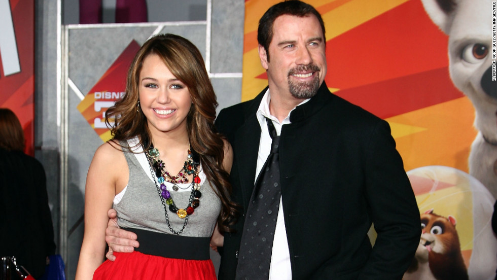 "Pushing her acting resume beyond ""Hannah Montana,"" Cyrus teamed with John Travolta for the 2008 animated feature ""Bolt."" Here, the co-stars arrive at the film's Los Angeles premiere in November 2008."