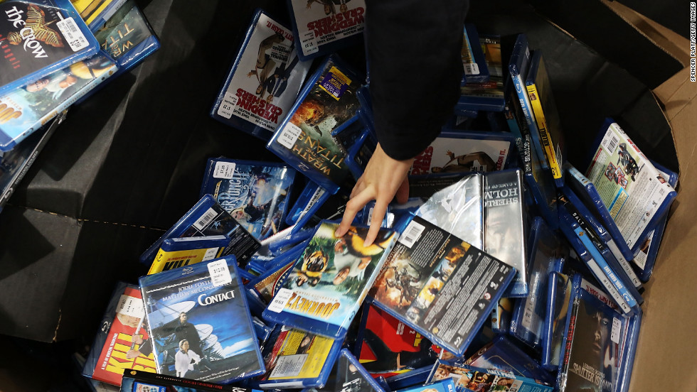 A shopper looks through movies and games at a Best Buy store in Naples, Florida.