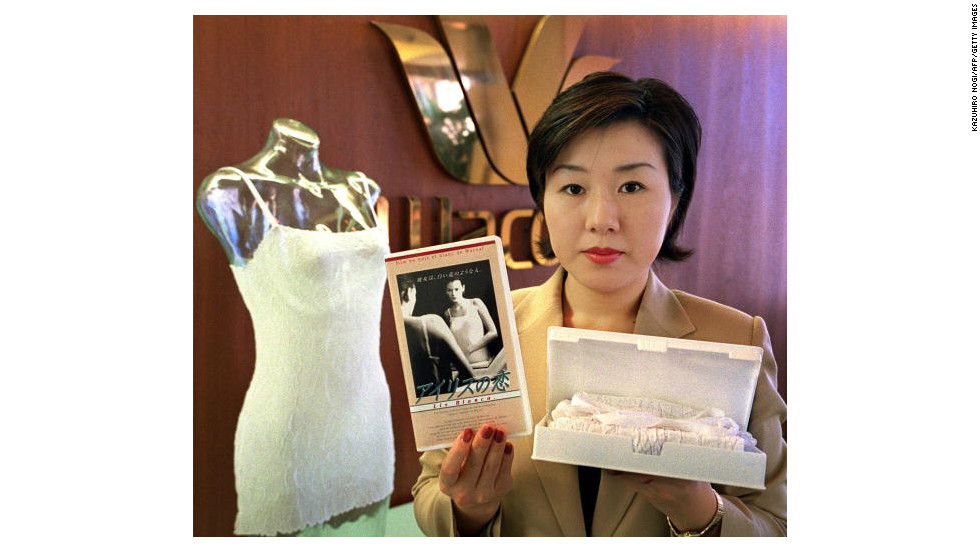 Chiaki Kobayashi, an employee of Japan's leading underwear maker Wacoal, displays 'cinema lingerie' packed in a video cassette tape case-- a gift to mark White Day, one of Japan's romantic holidays.