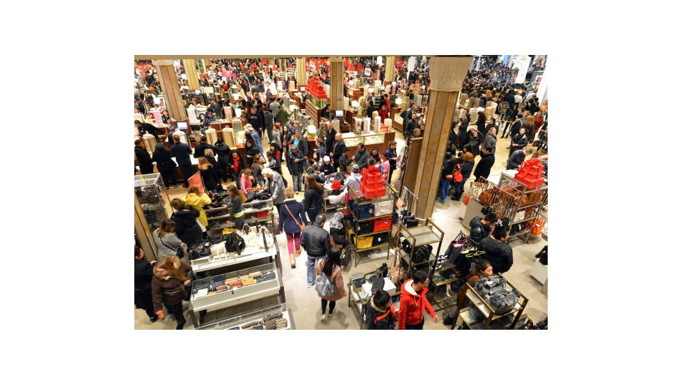 People crowd Macy's department store in New York at the start of Black Friday shopping weekend.  Thanksgiving is now victim to the Christmas shopping season, with stores welcoming shopaholics before the turkey can be taken from the oven.