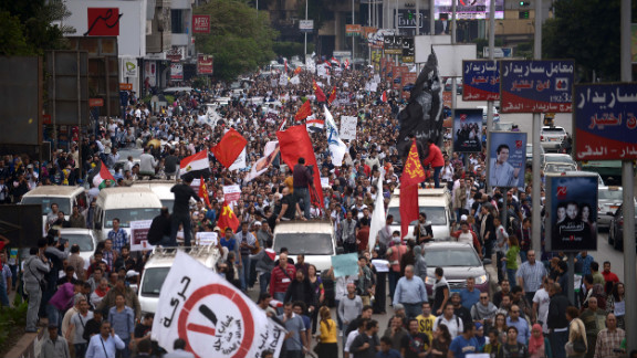 Thousands of demonstrators march through the streets of Cairo to protest against Morsy on Friday.