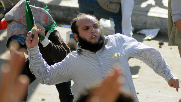 A man throws a rock during clashes in Alexandria on Friday.