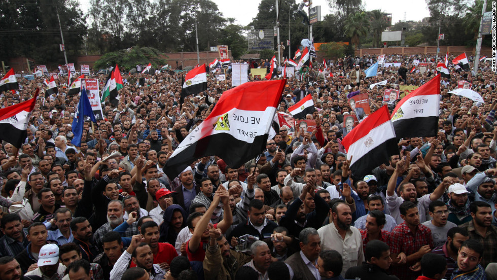 "Morsy supporters gather outside the presidential palace in Cairo on Friday. Morsy insisted that Egypt was on the path to ""freedom and democracy,"" as protesters held rival rallies over sweeping powers he assumed that further polarized the country's political forces."