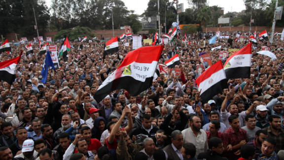 "Morsy supporters gather outside the presidential palace in Cairo on Friday. Morsy insisted that Egypt was on the path to ""freedom and democracy,"" as protesters held rival rallies over sweeping powers he assumed that further polarized the country"
