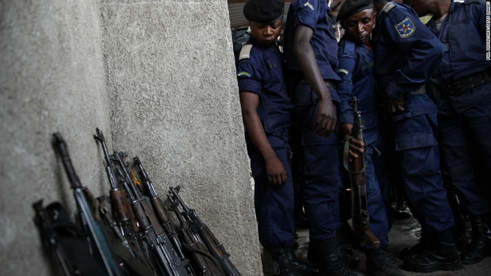 Surrendered police officers hand-in their weapons at the Volcanoes Stadium in Goma, in the east of the Democratic Republic of the Congo, on November 21, 2012.