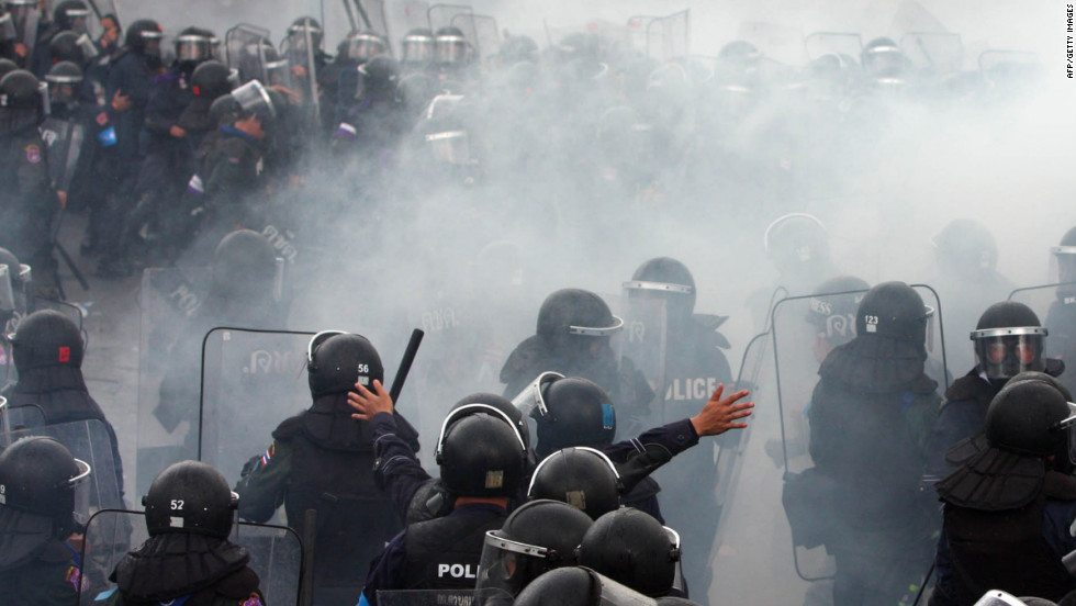 Thai riot police officers clash with demonstrators on Saturday.