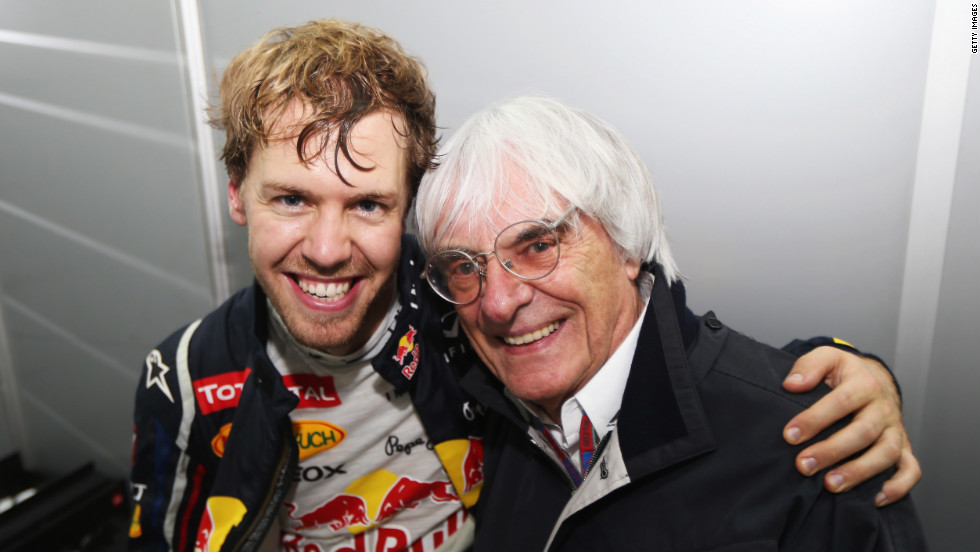 Vettel celebrates with Formule One supremo Bernie Ecclestone following his title win in Brazil.
