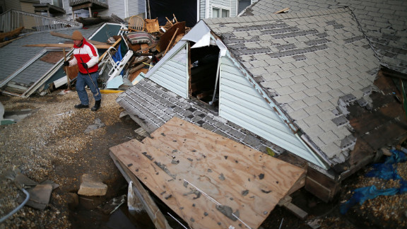 David McCue stands near the roof of his beach house, which was completely demolished by Superstorm Sandy, in Ortley Beach, New Jersey, on Sunday, November 25. See photos of the immediate aftermath of Sandy.