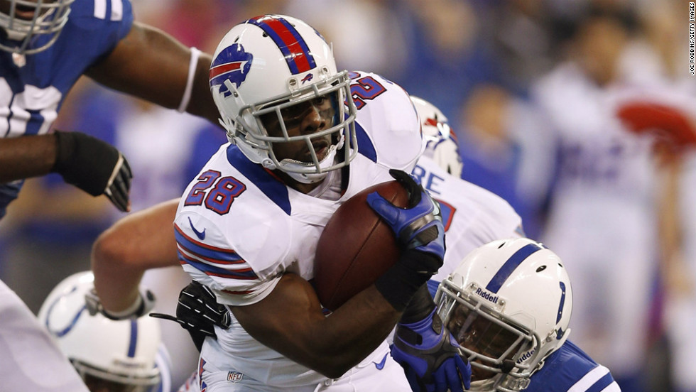 C.J. Spiller of the Bills gets tackled from behind by Kavell Conner of the Colts on Sunday.