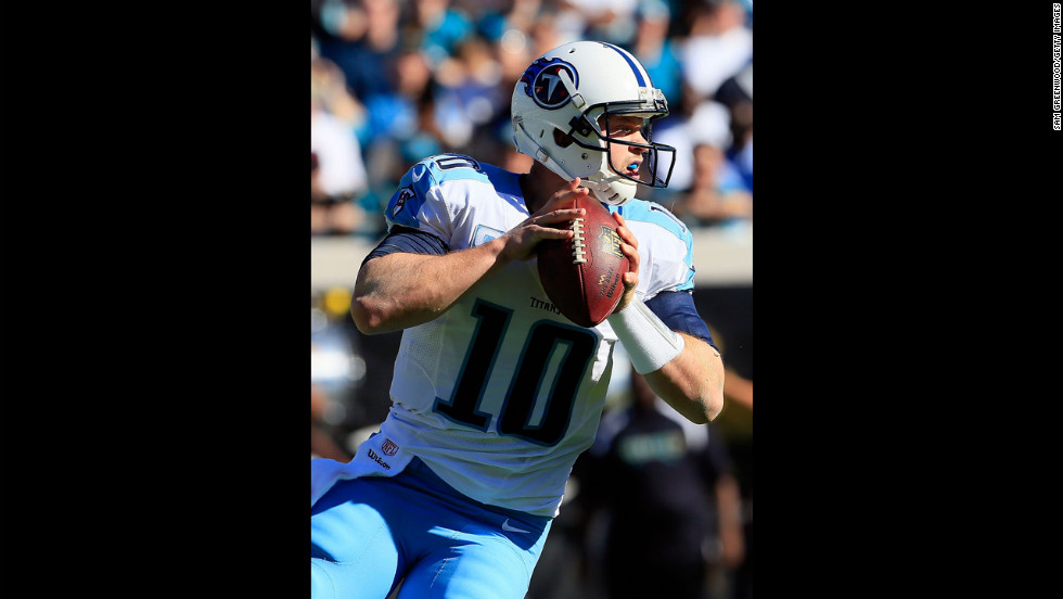 Jake Locker of the Titans attempts a pass against the Jaguars on Sunday.