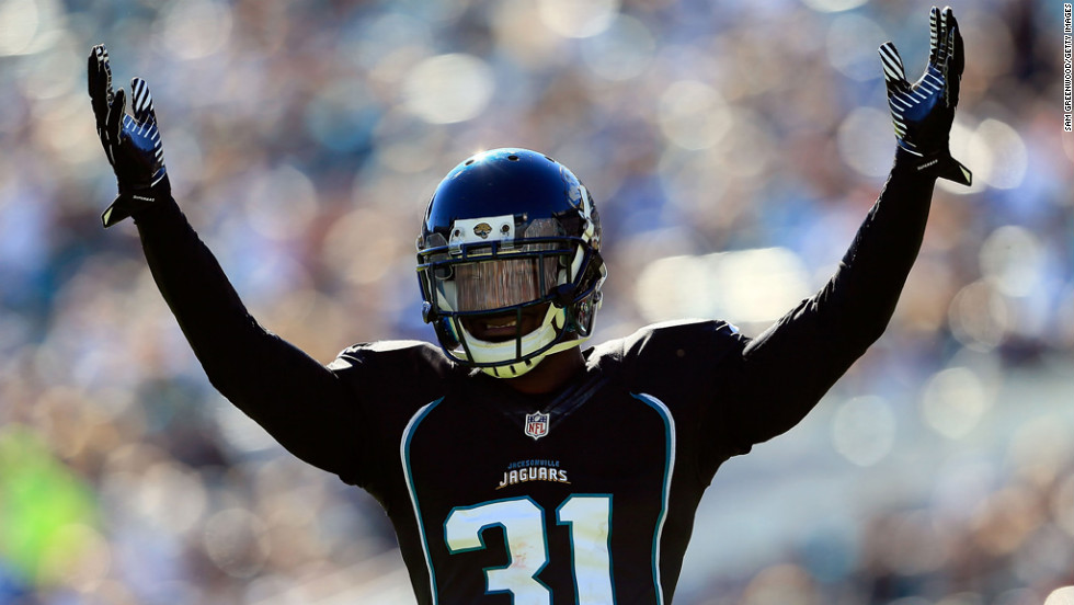 Aaron Ross of the Jaguars raises his arms against the Titans on Sunday.