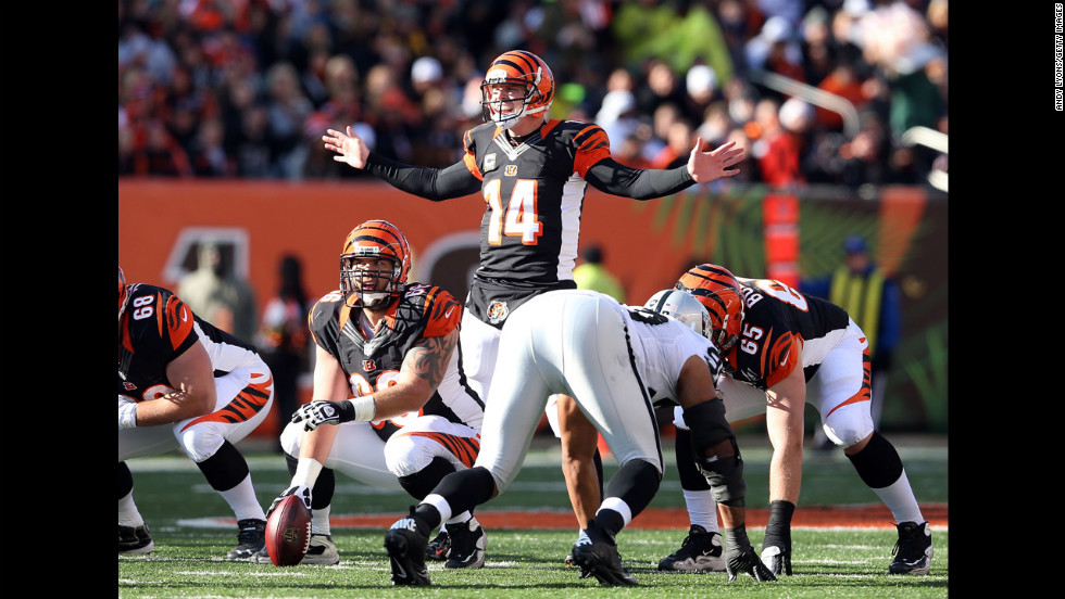 Andy Dalton of the Bengals gives instructions to his team during the game against the Raiders on Sunday.