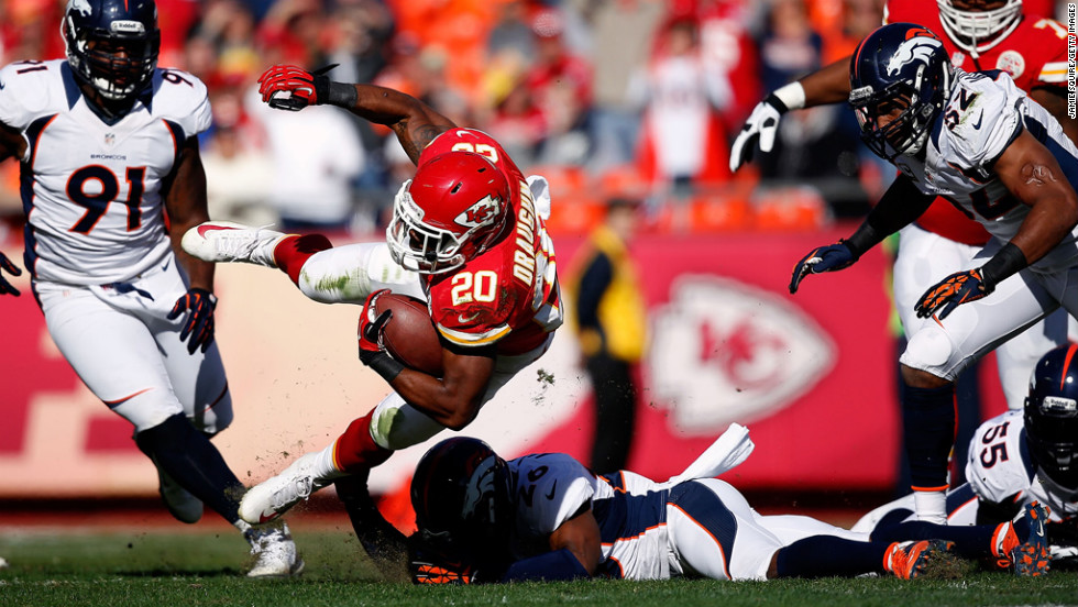 Running back Shaun Draughn of the Kansas City Chiefs carries the ball against the Denver Broncos at Arrowhead Stadium on Sunday in Kansas City, Missouri.