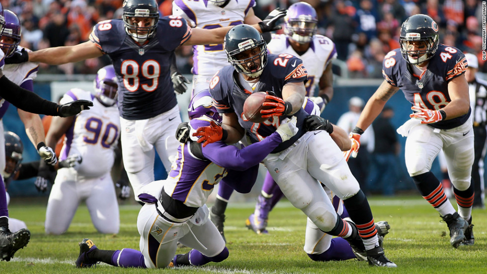 Michael Bush of the Bears scores a touchdown against the Vikings on Sunday.