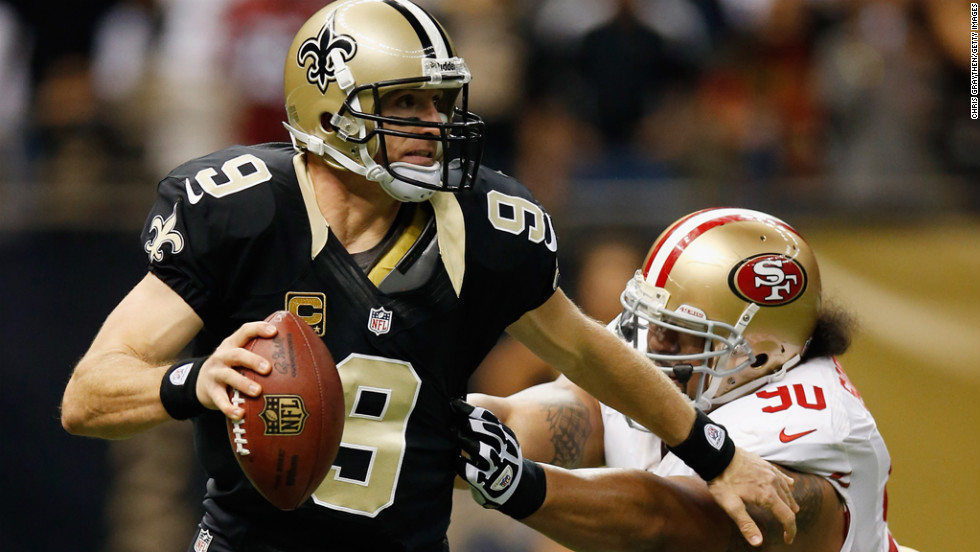 Drew Brees of the Saints is pressued by Isaac Sopoaga of the 49ers on Sunday.