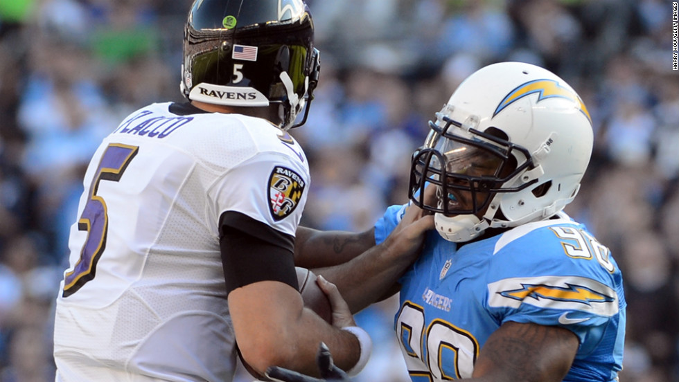 Antwan Barnes of the Chargers sacks Joe Flacco of the Ravens during the second quarter on Sunday.