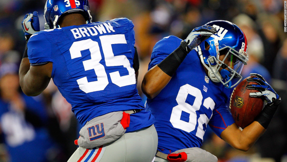 Rueben Randle of the New York Giants, right, celebrates with teammate Andre Brown after scoring a touchdown in the first quarter against the Green Bay Packers.
