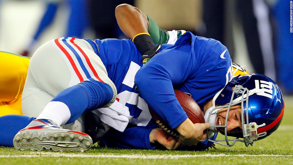 Tramon Williams of the Packers tackles Giants quarterback Eli Manning in the open field at MetLife Stadium on Sunday.