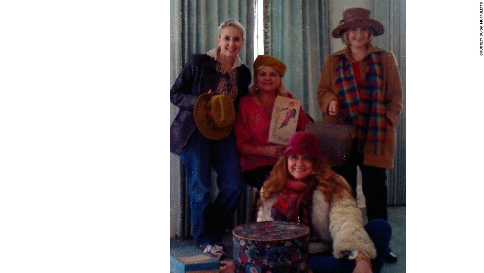 Nita Gilmore, Sherry Downs, Margaret Collins Jenkins and Ouida Muffuletto gather in the late 1990s in an antebellum mansion in Vicksburg, Mississippi, surrounded by hat boxes and items they purchased.