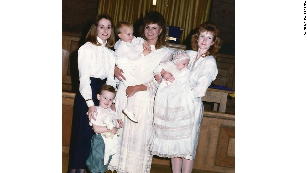 Nita Gilmore, left, Sherry Downs and Ouida Muffuletto come together for the christening of Downs' son in the late 1990s.