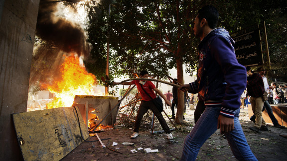 Protesters clash with Egyptian police at Simon Bolivar Square on Sunday, November 25, in Cairo. Egypt