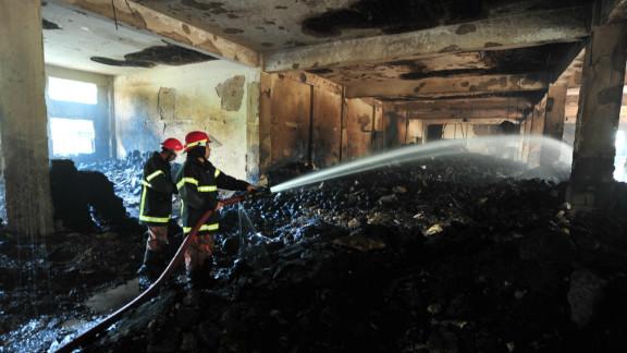 Firefighters douse hot spots on November 25.