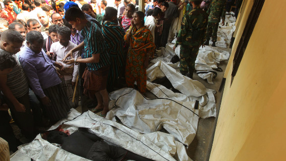 Bodies of victims are lined up in Savar on November 25. Many workers jumped from high windows to escape the smoke and flames.