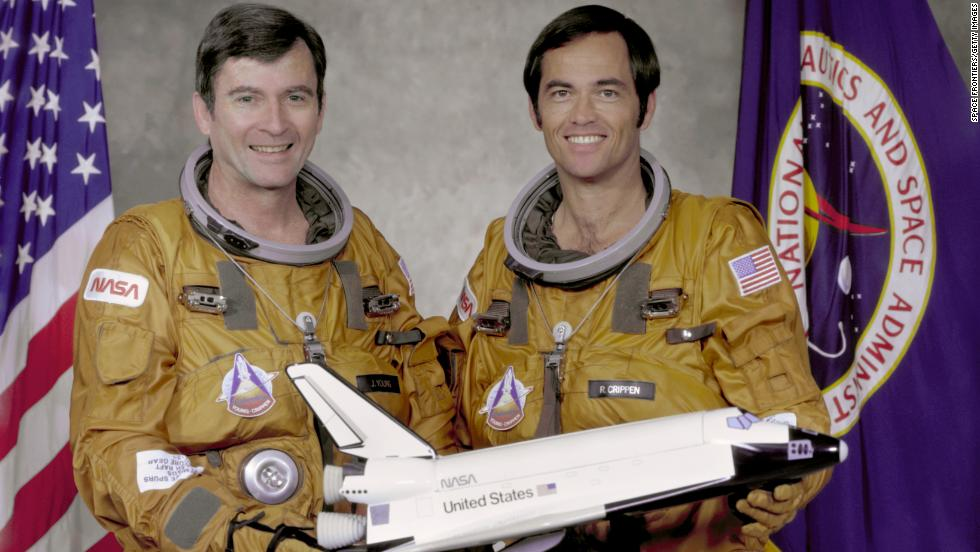 Taking off on April 12, 1981, Columbia made the first orbital flight of NASA's space shuttle program. Here, crew members John Watts Young, left, and Robert Laurel Crippen hold a model of the orbiter in 1979.