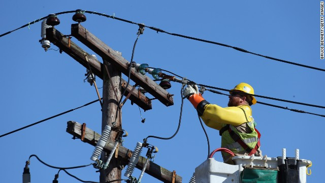 A worker repairs electrical lines as Long Islanders continue clean up efforts in the aftermath of Superstorm Sandy on November 9 in Plainview, New York.