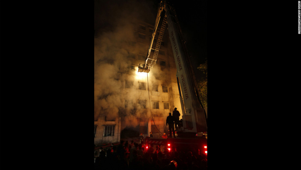Firefighters work at the nine-story plant on November 25.