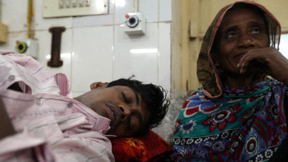 Masud Rana, one of the survivors, receives treatment at Dhaka Medical Hospital on November 26. The factory was owned by Tazreen Fashions, which manufactured clothing for C&A, Carrefour and Wal-Mart, reports said. Wages at the factory are about $43 a week for a garment worker.