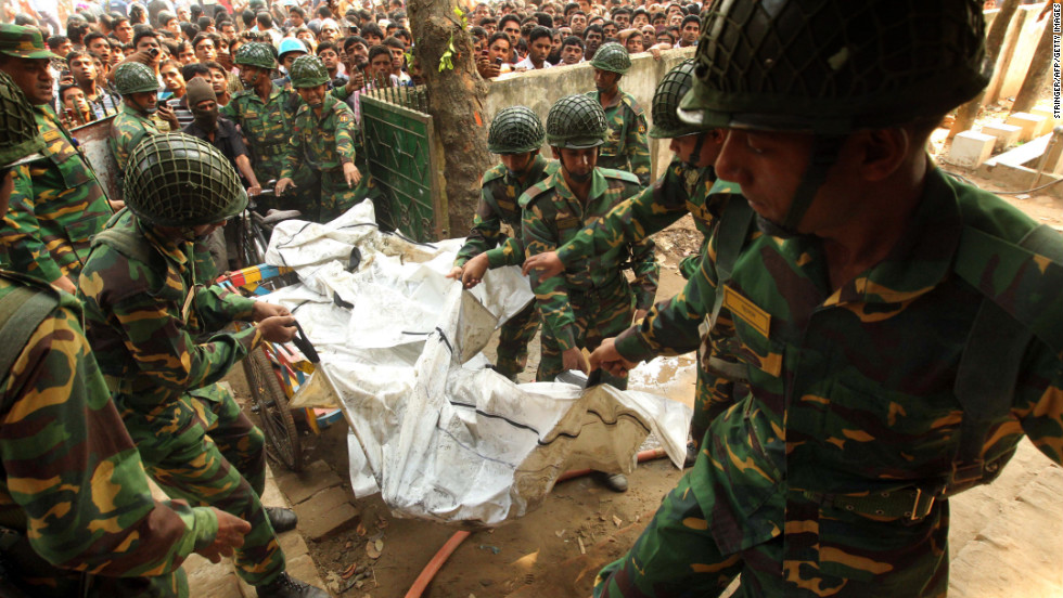 Bangladeshi army personnel transport the bodies of victims on November 25.