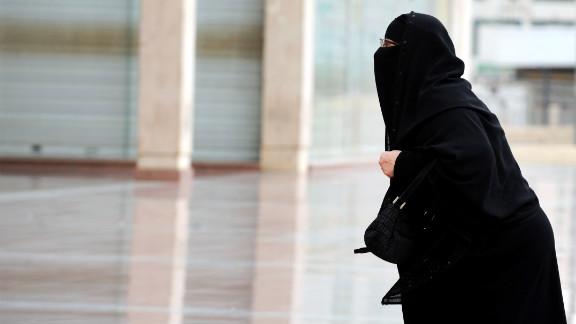 A fully veiled Saudi woman walks into a mall in Riyadh. Women