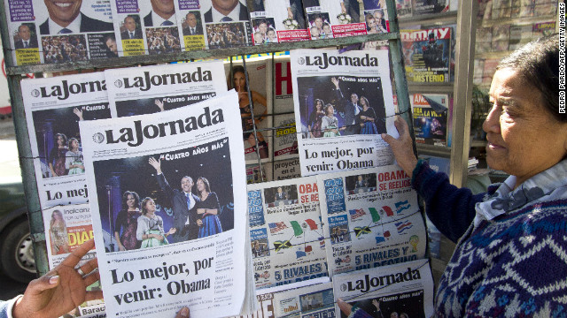 Newspaper headlines at a newstand in Mexico City report U.S. President Obama has won re-election.