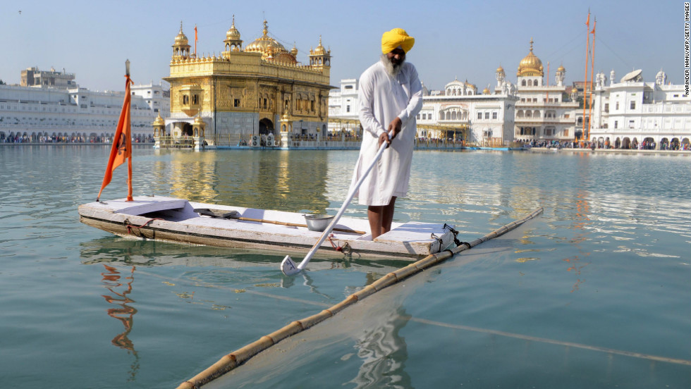 An Indian Sikh devotee cleans the sarovar at the Sikh Shrine Golden Temple in Amritsar on Tuesday.