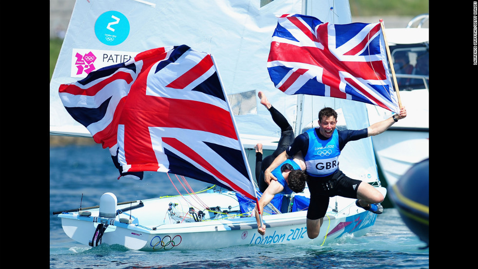 Luke Patience, left, and Stuart Bithell of Great Britain celebrate after finishing second and winning the silver medal in the men's 470 Sailing on Day 14 of the London 2012 Olympic Games on August 10 in Weymouth, England.