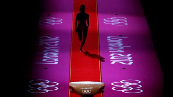 A gymnast performs during warmups before the start of the artistic gymnastics women
