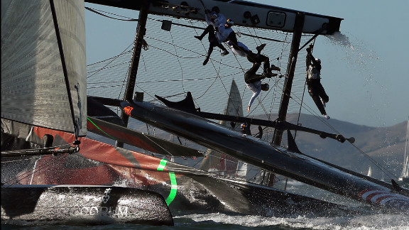 The Oracle Team USA flips over during a fleet race in the America