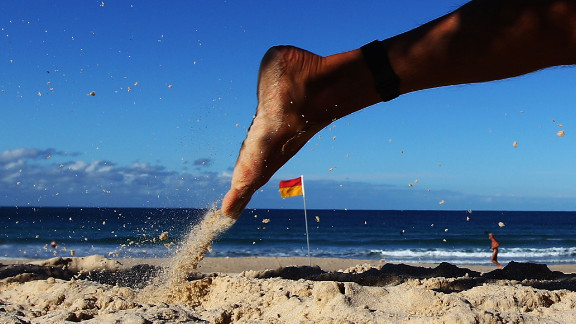 A competitor runs along the beach during the 2012 Bondi Barefoot Race at Bondi Beach on May 27 in Sydney, Australia.
