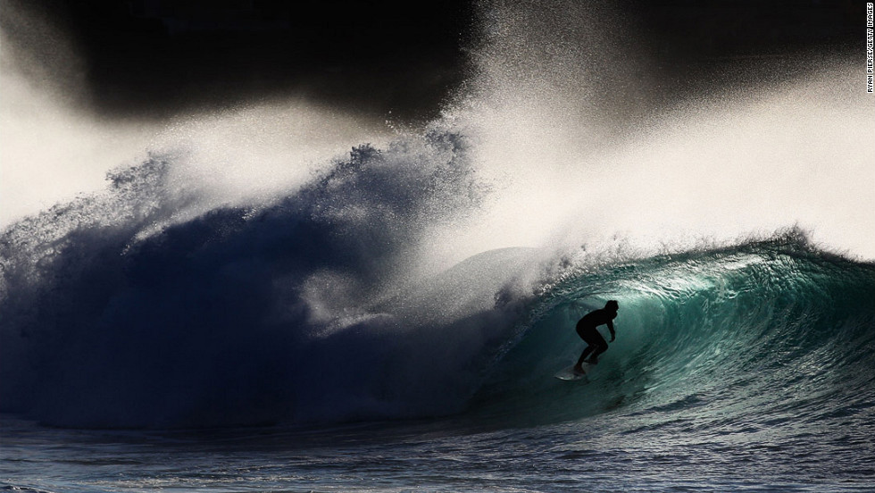 A surfer rides a wave at Bronte Beach on May 8 in Sydney, Australia.