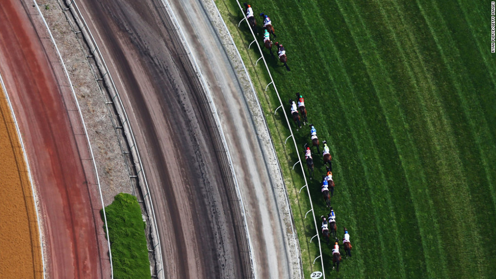 Riders race in the AAMI Victoria Derby during Victorian Derby Day at Flemington Racecourse on November 3 in Melbourne, Australia.
