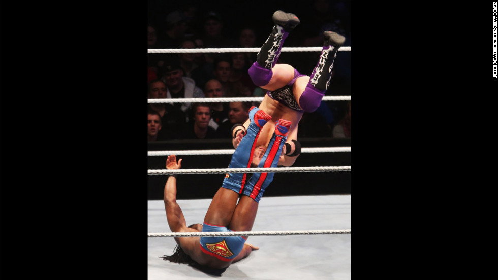 Kofi Kingston, bottom left, competes in the ring against The Miz during the WWE SmackDown World Tour on November 2 in Hamburg, Germany.