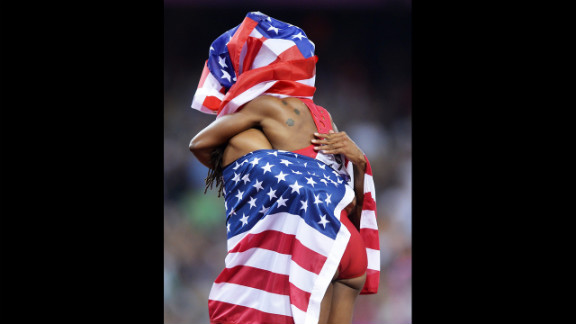 Jason Richardson, left, and Carmelita Jeter celebrate after placing third in the women