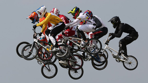 Riders take a jump in the men